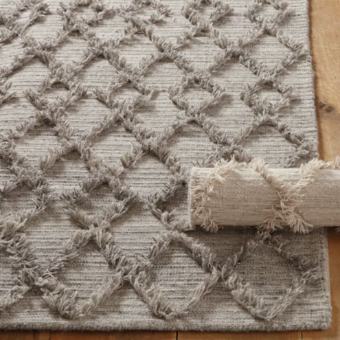 Jakori Geometric Wool Area Rug